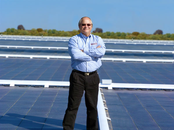 Pete Wenzel, President and CEO of General Data, with the solar panels on the rooftop of the Ferguson manufacturing facility